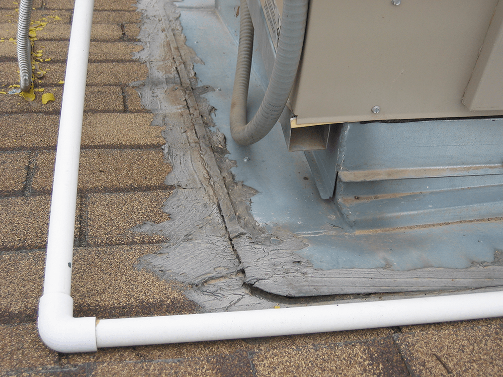 This pic shows the curb the unit sits on wasn't install into the composite roof shingles